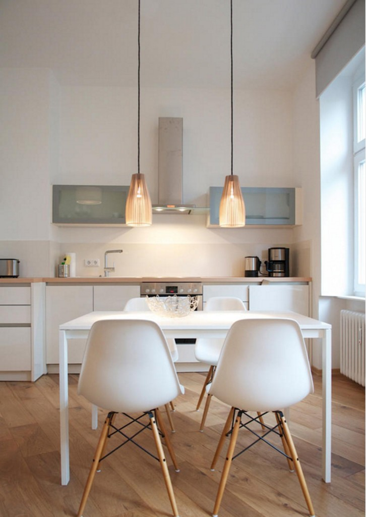 Simple white dining table and Eames chairs in modern kitchen-dining tables