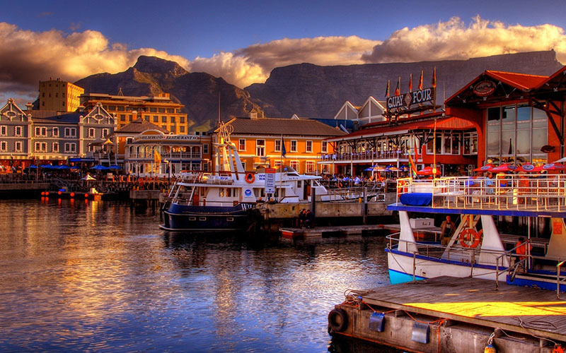South-Africa,-Cape-Town-fall-harbor-boats-ocean-mountains-beautiful-buildings