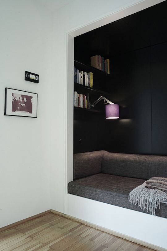 minimalistic reading nook in grey colors purple lamp