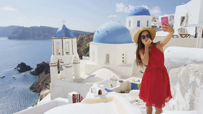 Santorini,-Greece-Woman-In-Red-Dress-Taking-a-Selfie-Selfies-Selfie-take-a-selfie-the-selfie-best-selfie-selfie-stick