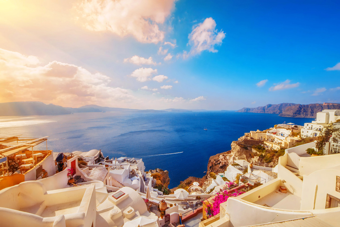 Santorini,-Greece-beautiful-sunshine-view-from-above-white-houses-flowers-sea