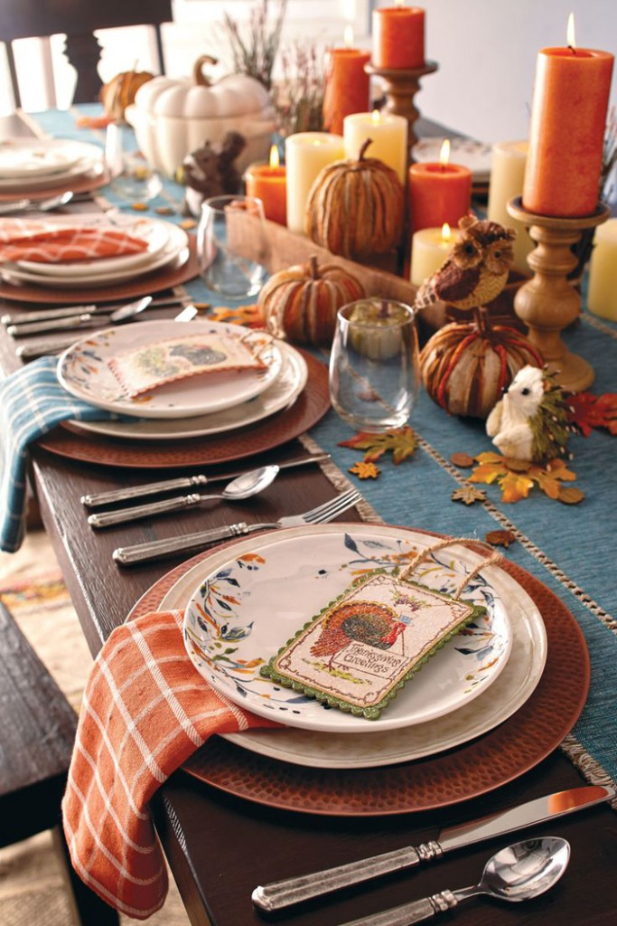 Table-Orange-Candles-Leaves-Pumpkins-thanksgiving-centerpiece-thanksgiving-table-settings-inexpensive-thanksgiving-table-decorations-thanksgiving-table-decor-ideas-centerpiece