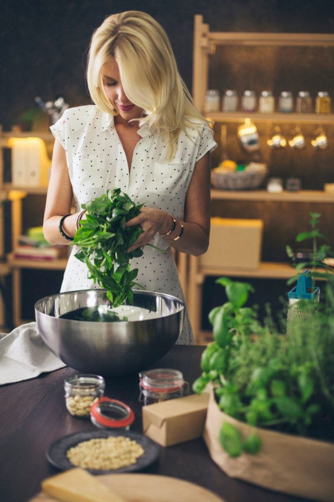 home herbs basil woman in kitchen growing herbs indoors herb garden window herb garden kitchen herb garden growing herbs herb planter indoor