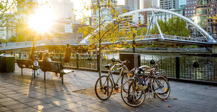 Melbourne-City-Bicycles-River-Bridge-Happy-People-solo-travel-companies-places-to-travel-alone-solo-female-travel-solo-travel-destinations