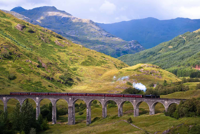 West-Highland-Line-Train-Beautiful-Landscape-Mountains-Green-train-travel-rail-travel-great-train-journeys-train-vacations-packages-best-train-trips-scenic-railroad-trips