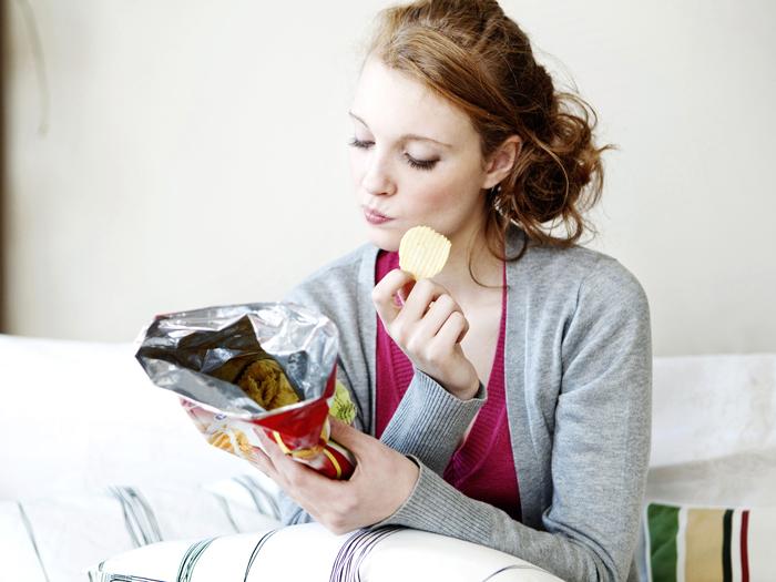 Woman-Eating-Snack-in-Livingroom-Snacks-healthy-snacks-snack-ideas-easy-snacks-snack-foods-evening-snacks