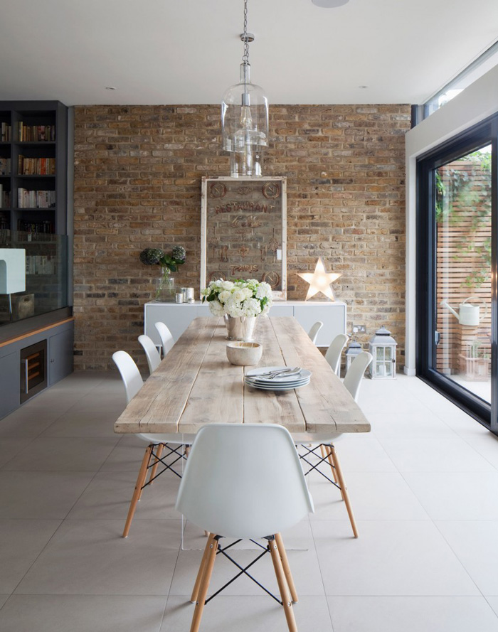 Brick-Wall-In-Dining-Room-Wooden-Table-Natural-Decor-Home-White-Cahirs-Scandinavian-Style-Dining-Room-Cozy-Home