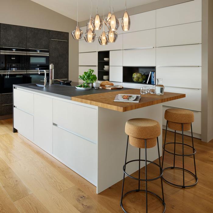 Modern-Big-KItchen-Island-with-Cork-Modern-Chairs-Big-Storage-Space