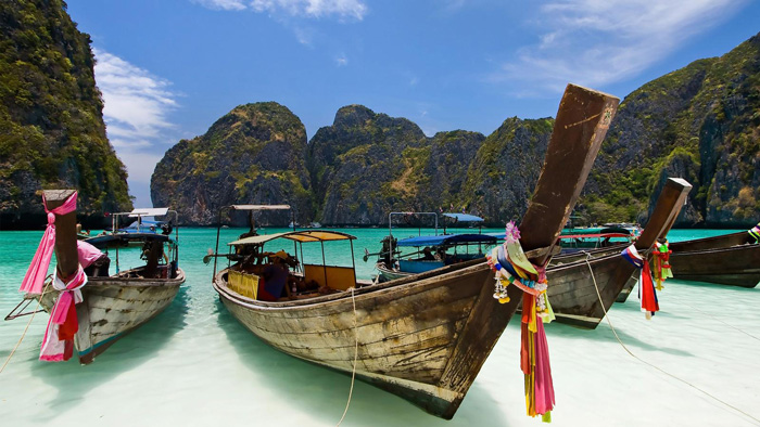 Boats-Parked-on-a-Sandy-Beach-Thailand-Top-5-Tropical-Destinations-That-Will-Make-You-Forget-About-the-Winter