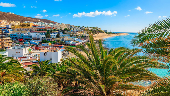 Fuerteventura-Canary-Islands-Colorful-Hotels-Beach-Palms-Sunny-tropical-vacations-tropical-vacation-spots-tropical-vacation-destinations-beach-vacation-spots-tropical-island-holidays-tropical-places