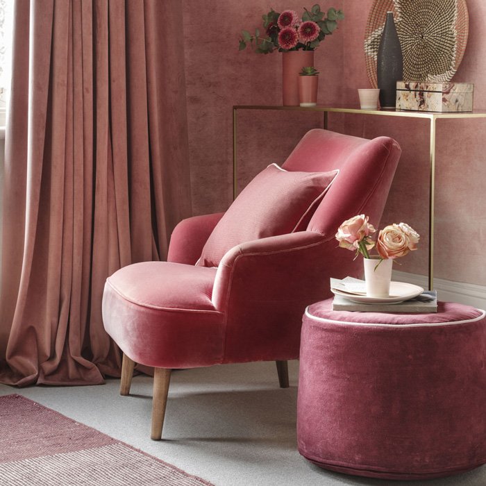 Coral-and-blush-pink-wall-paint-design-soft-velvet-armchair-pink-decoration