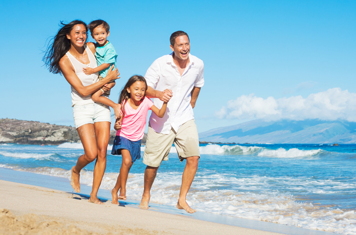 Happy-family-On-The-Beach-Family-Vacations