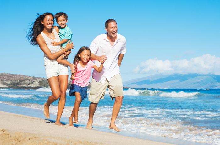 Happy-family-On-The-Beach-Family-Vacations