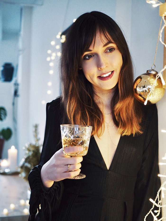 Woman Drinking champagne on New Years Eve