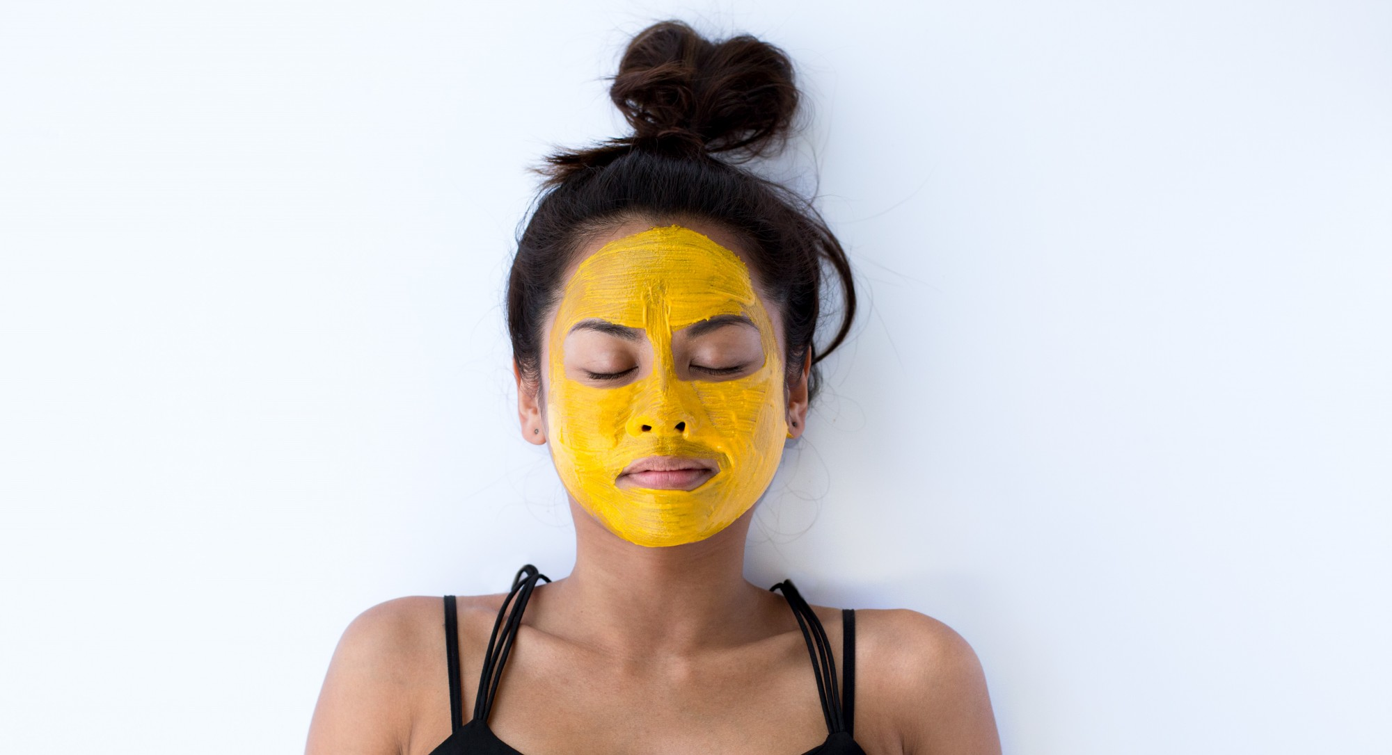 Woman with Natural Yellow Face Mask