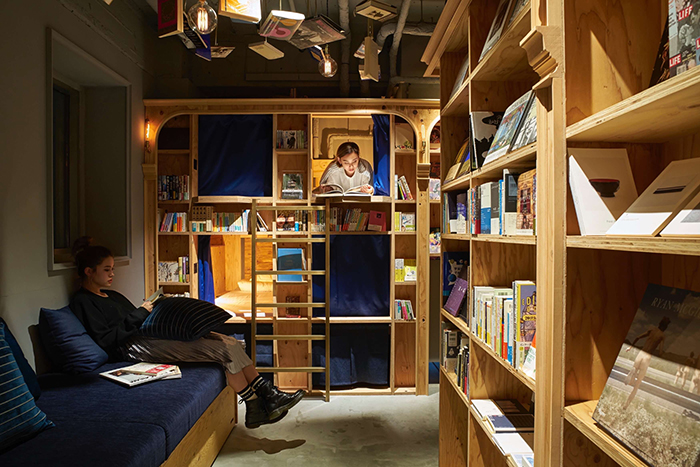 Women reading and resting in book and bed bookstore Tokyo