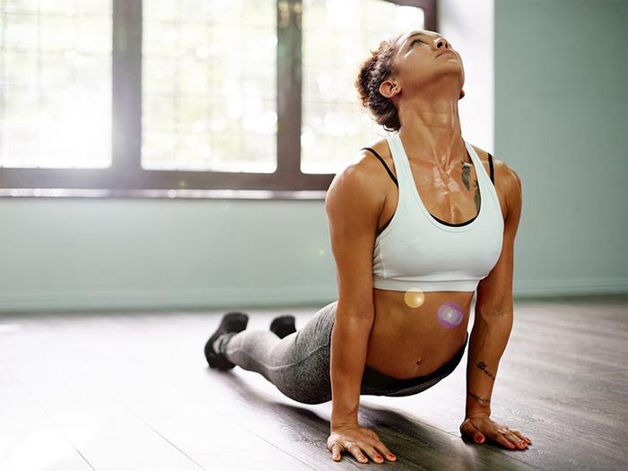 Sweat woman doing hot yoga