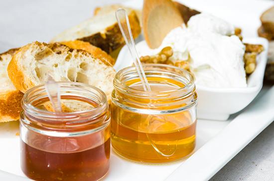 Small jars full of honey for breakfast