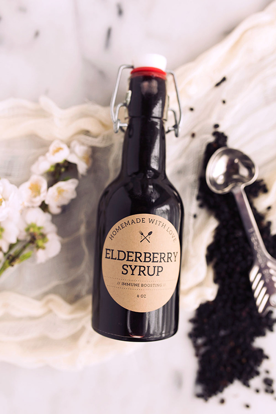 Homemade Elderberry Syrup in a glass bottle