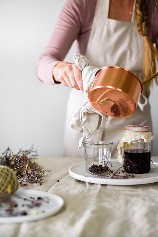 Woman making Homemade Elderberry Syrup and Jam
