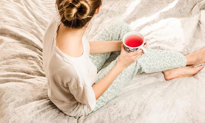 Woman drinking tea before sleep ritual