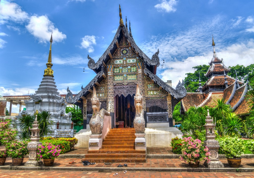 Colorful temple in Thailand surrounded with nature