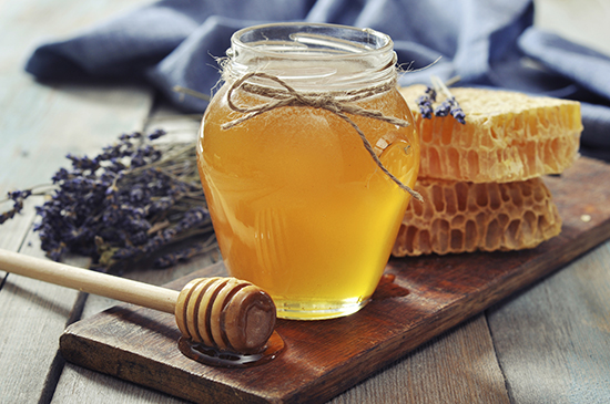 Natural honey in a jar with lavender
