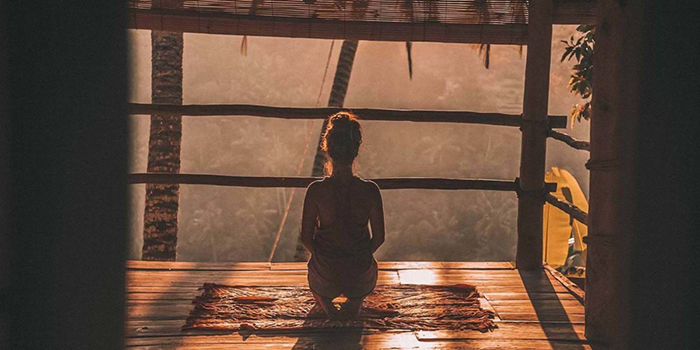 Girl Meditates in the nature