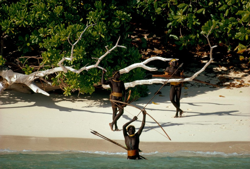 Sentinelese warriors standing at the beach holding arrows