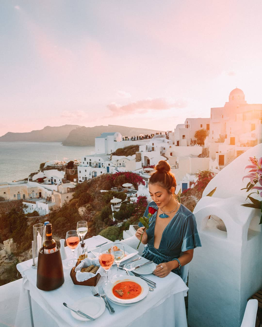 Woman having lunch at Ambrosia restaurant Santorini