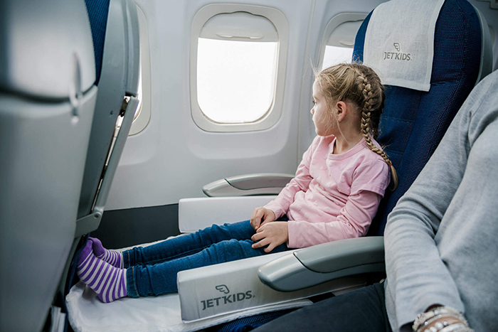 Girl flying on a plane