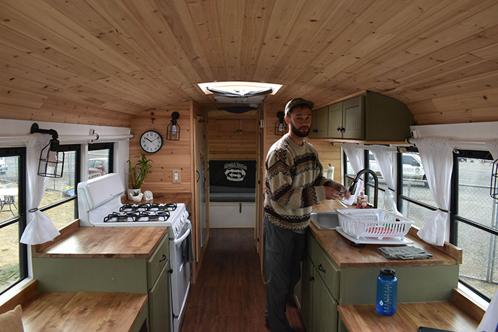 Man in a tiny bus house