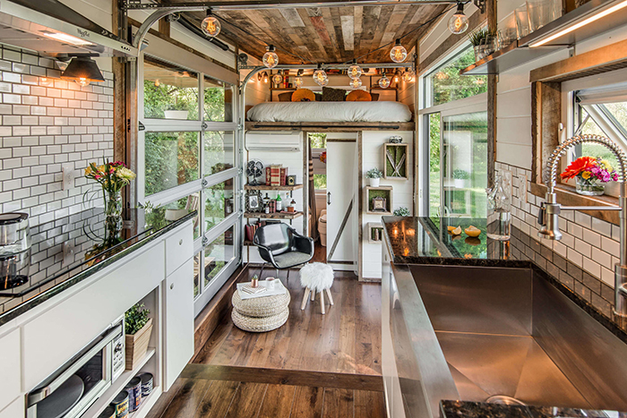 Charming cozy tiny house interior with vintage lights
