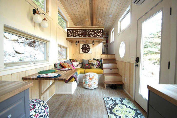 Wooden tiny house interior with large table