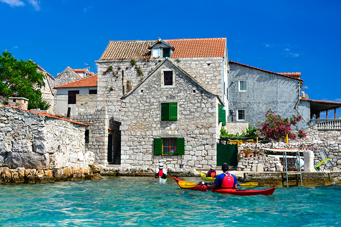 Men kayaking in Dalmatia Croatia