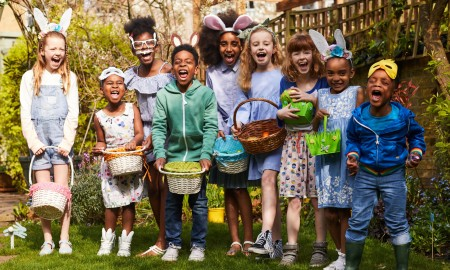 Happy kids collecting Easter eggs