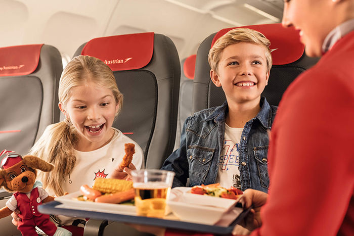 Kids having lunch served on a plane