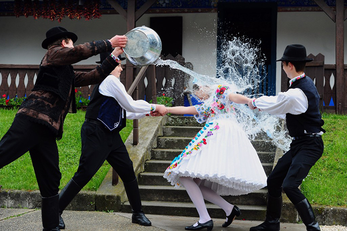 Hungary Easter tradition boys showers girl with water
