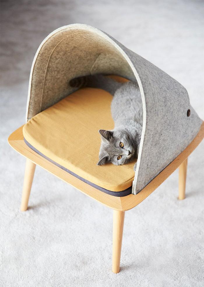Cat in a simple pet house Scandinavian Design