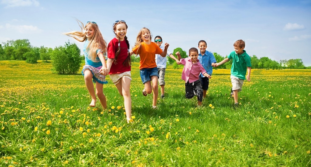 Kids running on the meadow