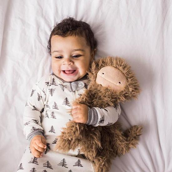 Baby boy hugging his plush toy