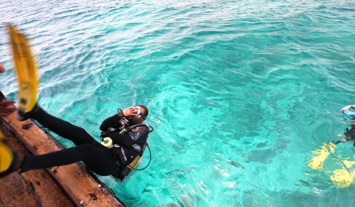 Diver going underwater in Lake Malawi, East Africa