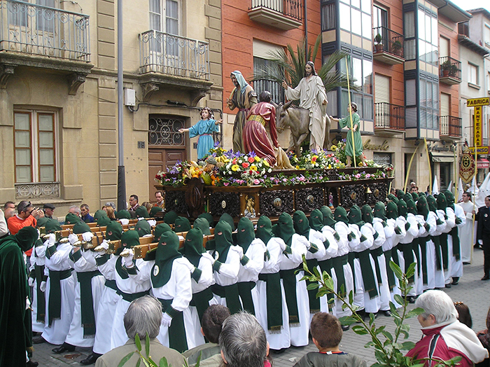 Men carrying Jesus Christ statue on the streets in Spain for Easter