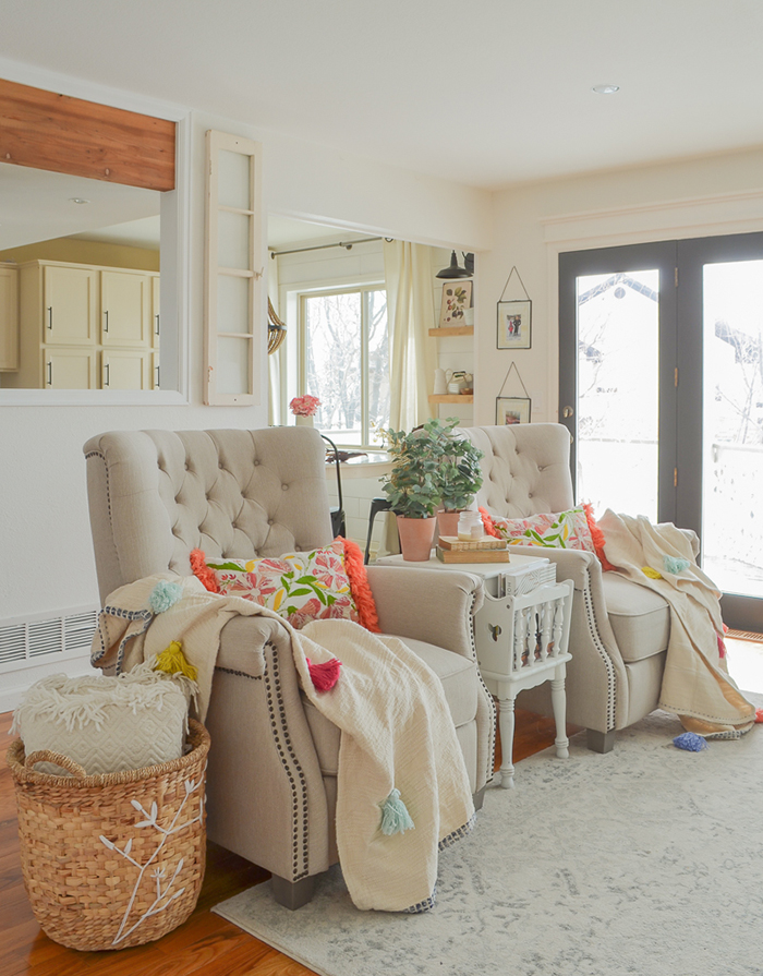 Armchairs with colorful pillows and spring decor