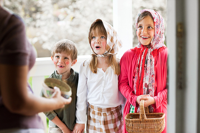 Kids gathering sweets for Swedish Easter tradition