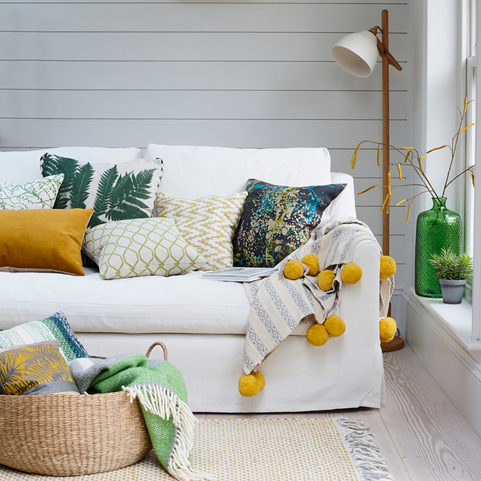 Fresh textile pillows on a sofa