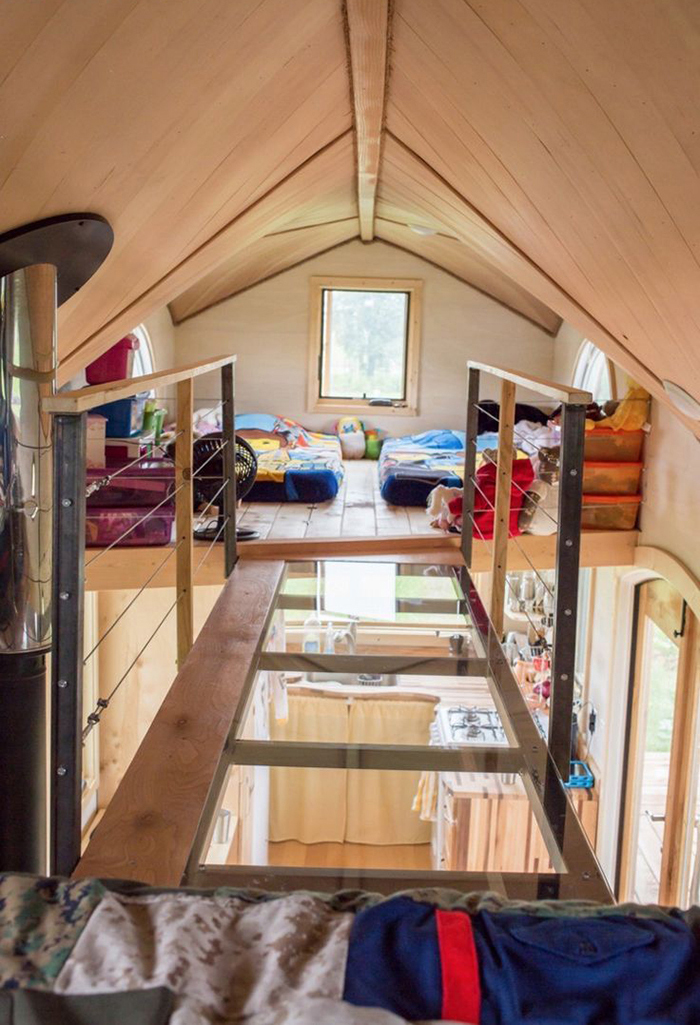 Beds on the second floor of tiny house on wheels