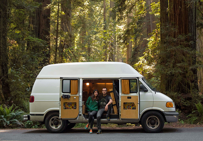Couple sitting on a van house