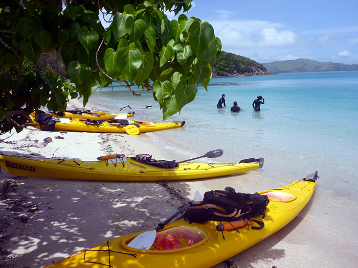 Yellow kayaks on the beach ready to go in Whitsunday Islands, Australia
