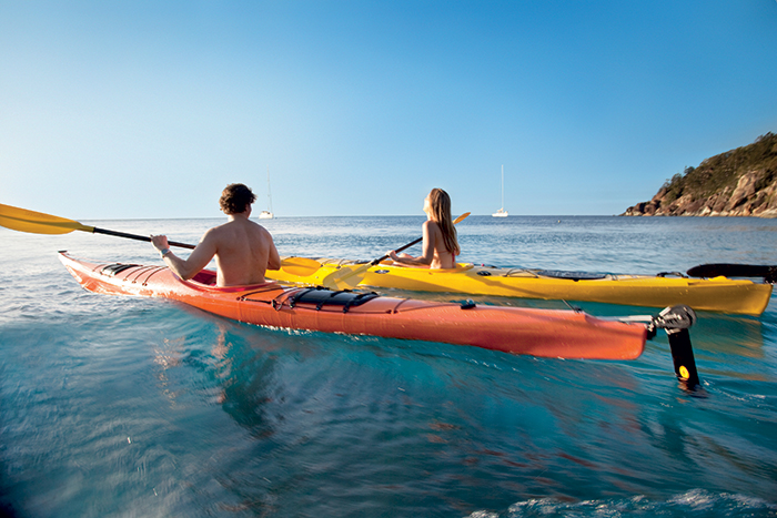 Man and Woman having fun while kayaking in Whitsunday Islands, Australia